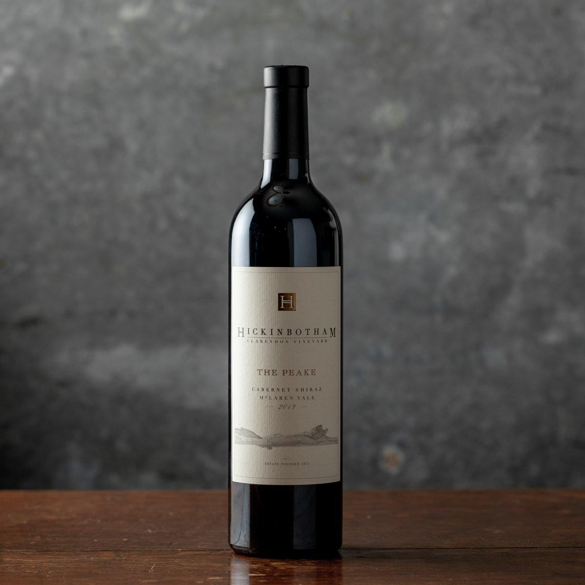 Wine bottle of The Peake Cabernet Shiraz against a gray backdrop
