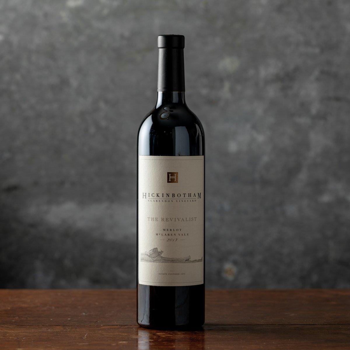 Wine bottle of The Revivialist Merlot against a gray backdrop